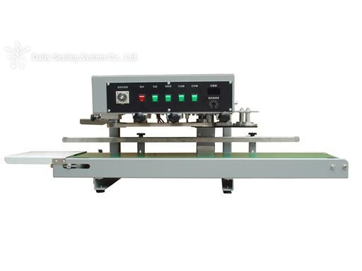 Tabletop vertical rotary sealer